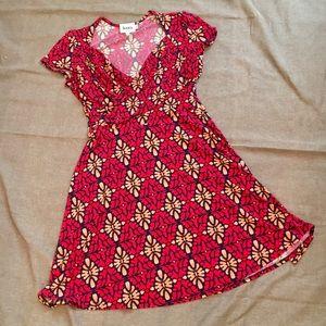Leota sweetheart neckline dress.